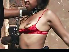 Curly haired slave from Africa sucks dicks and gets fucked outdoors