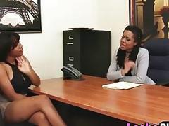 Two outstanding ebony lesbian babes having fun in the office